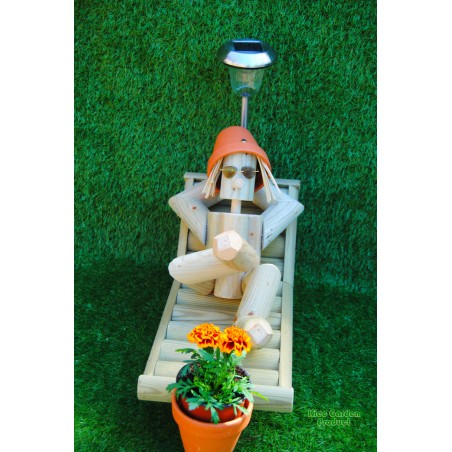Man on a deckchair with a solar lamp