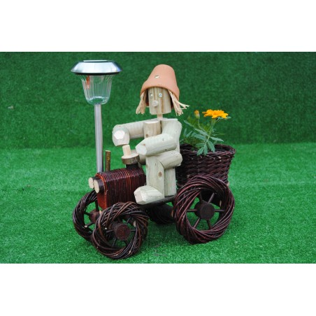 Man on a small dark wika tractor with solar light