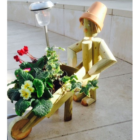 Girl or boy with wheelbarrow with a solar lamp