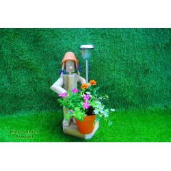 Stading girl holding a pot with a solar light