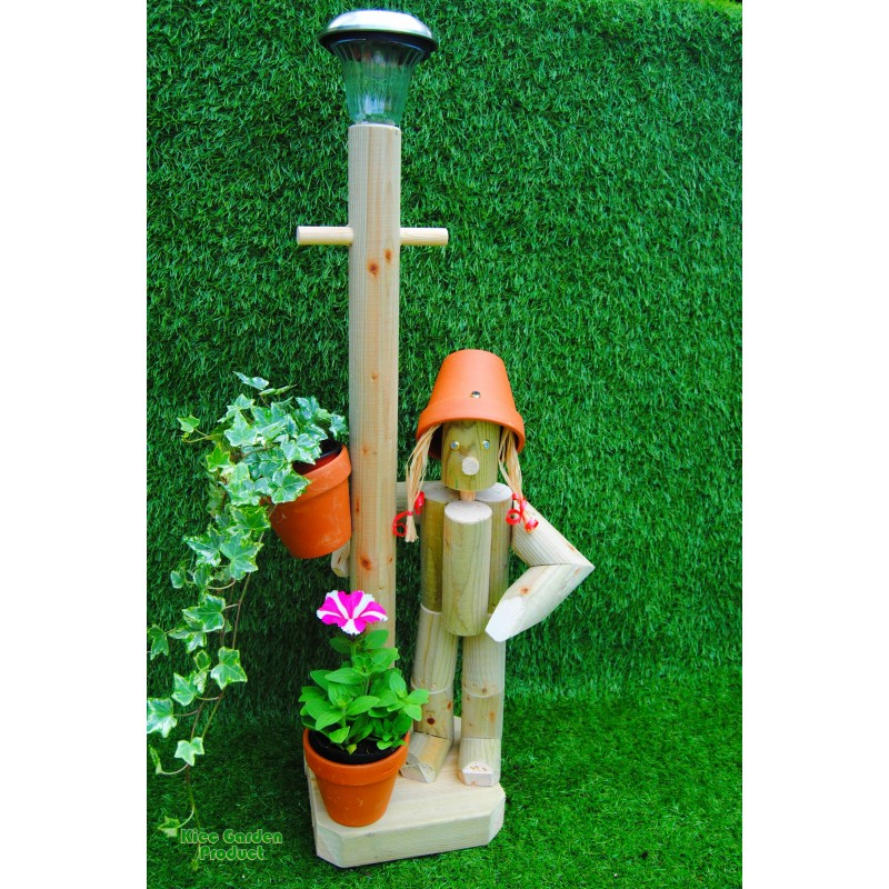 Girl or boy with a tall lamp post