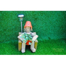 Girl or boy sitting on a chair with solar light