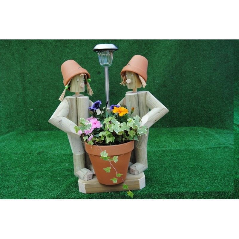 Couple holding a pot with solar light