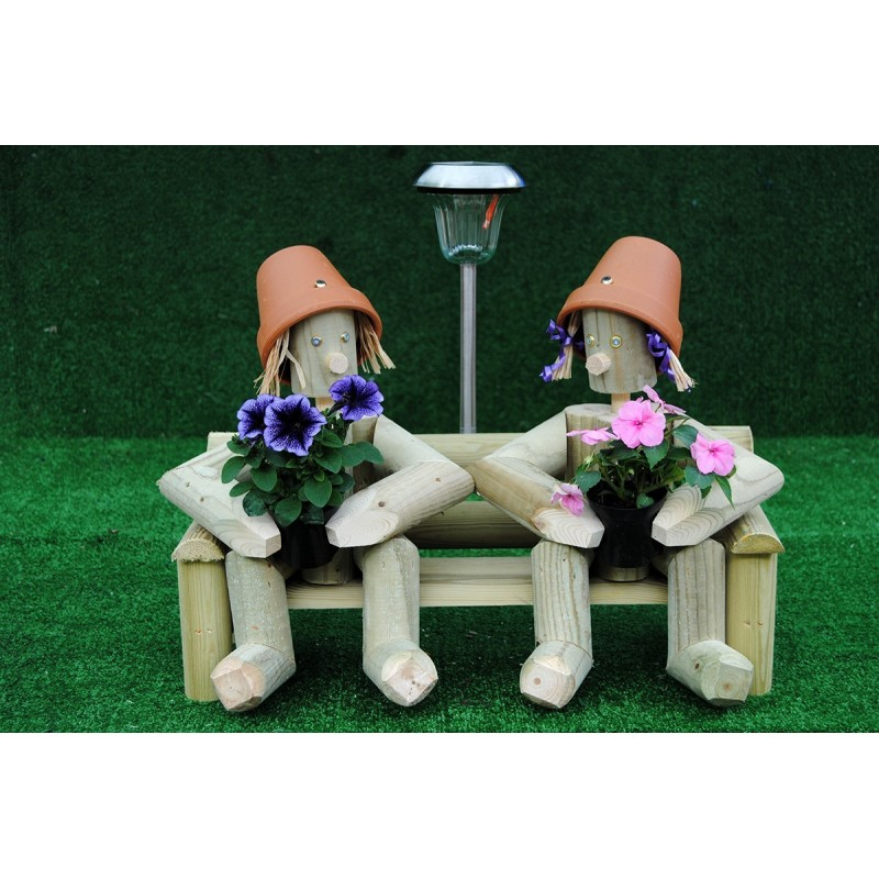 Couple sitting on a bench with solar light