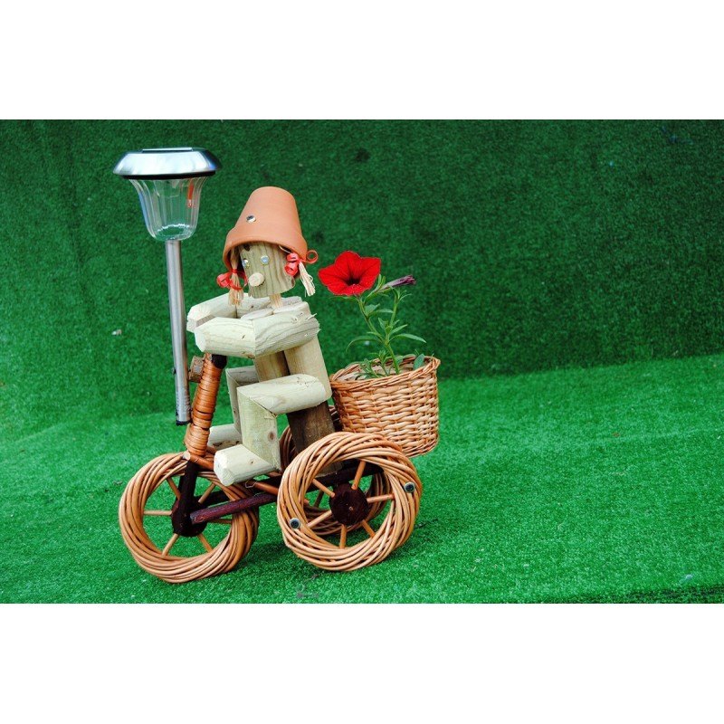 Girl on a bright wika bike with solar light