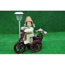 Girl on a dark wika bike with solar light