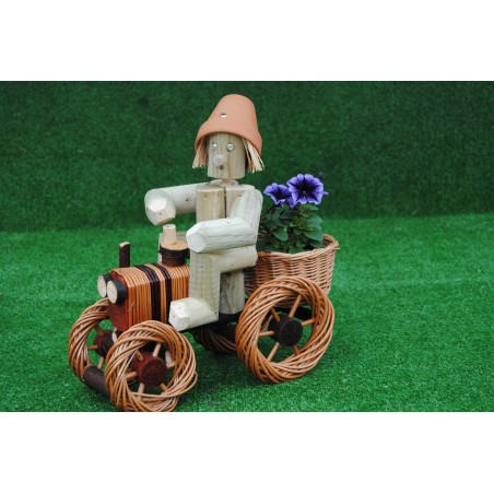 Man on a small bright wika tractor
