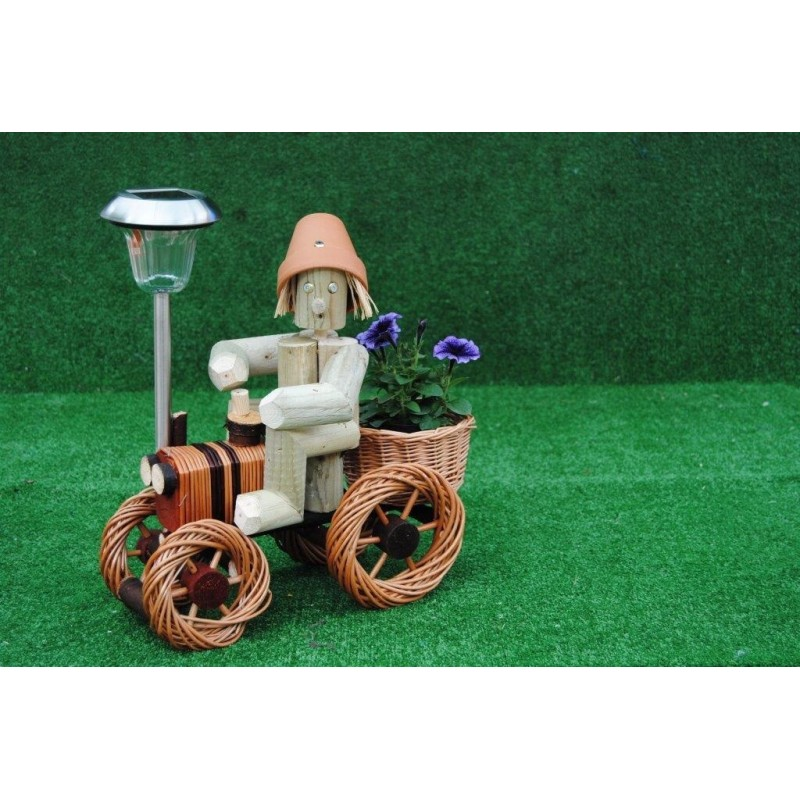Man on a bright wika tractorgy with solar light