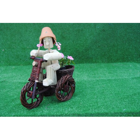 Girl or Boy on a small dark wika bike